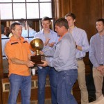 "Bill Barry '77 presents ""Tau Madness"" trophy to 2014 winner Frank Kulze '75"