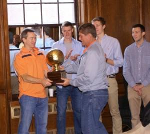 "Bill Barry '77 presents ""Tau Madness"" trophy to winner Frank Kulze '75"