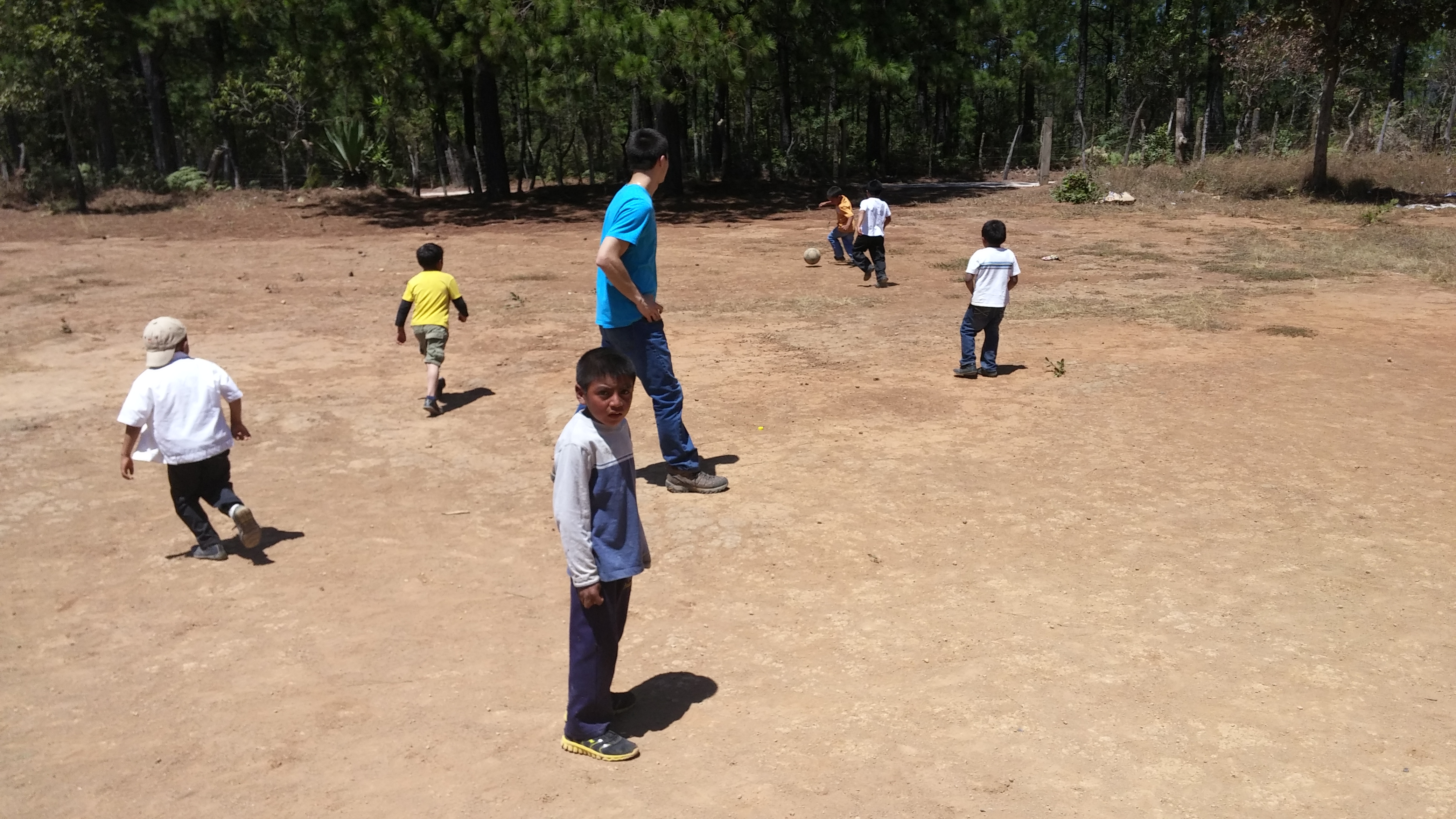 Playing soccer with the children
